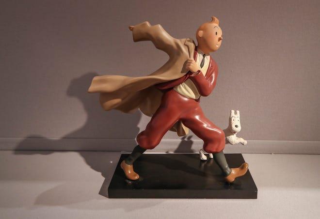"""Patung resin polikrom tahun 1988 dari karakter komik Tintin dan anjingnya bersalju dari tahun 1941 """"Kepiting dengan Cakar Emas"""" album. Karya seni dengan perkiraan nilai 400 hingga 900 euro (US $ 486 hingga 1095), akan dijual Kamis."""