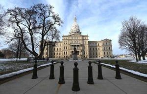 Michigan House OKs .2B in COVID spending, ties .2B to power checks