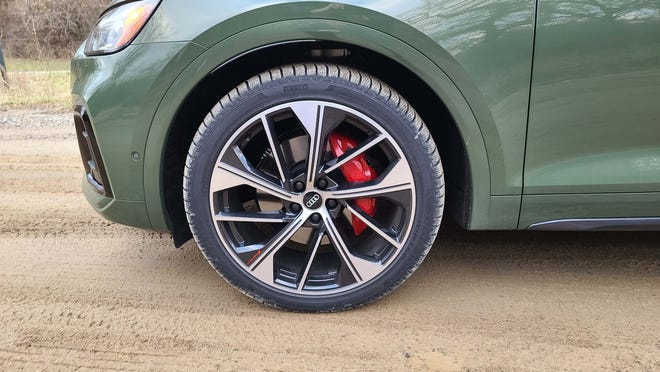 An S Sport package options red brake calipers for the 2021 Audi SQ5 — one of many goodies available on the performance ute.