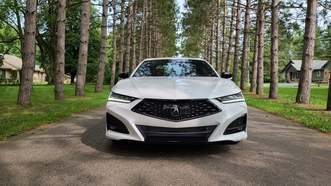 The distinctive front end of the 2021 Acura TLX complete with A-Spec, dark trim.