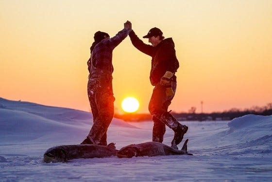 Evan and Lucas Muche celebrate after harvesting their sturgeon in 2020. The sturgeon spearing tradition will continue Feb. 13 with the DNR offering drive-thru harvest registration.