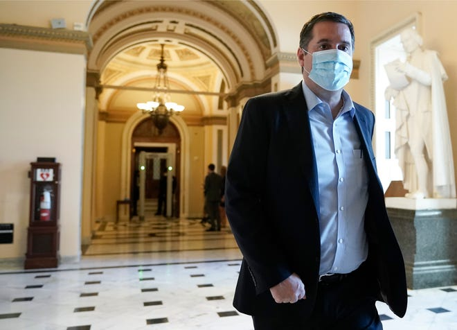 Rep. Devin Nunes, R-Tulare., walks at the Capitol in Washington, Wednesday, Jan. 13, 2021, as the House of Representatives. His lawsuit against CNN for defamation was rejected by a New York Court on Friday.