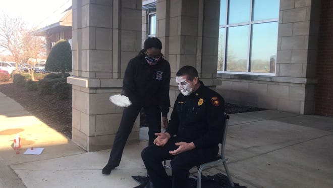 Madison County Fire Chief Eric Turner reacts seconds after taking a pie to the face to commemorate the 2020 Battle of the Badges Blood Drive at Lifeline Blood Services on Jan. 12, 2021.