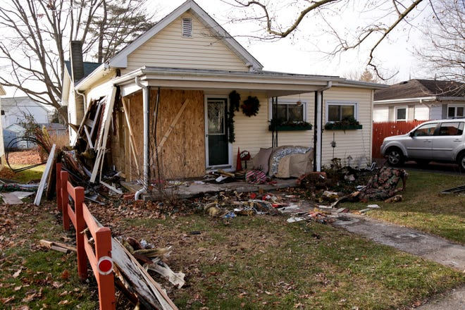 Damage is visible to a house on the 1800 block of Central Avenue after police reported a car attempting to flee from police crashed into it, Wednesday, Jan. 13, 2021 in Lafayette.