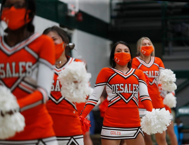 The DeSales cheerleaders entertain the crowd during a timeout. 01/12/21