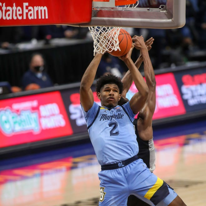 Marquette freshman Justin Lewis pulls down a rebound against Providence on Tuesday.