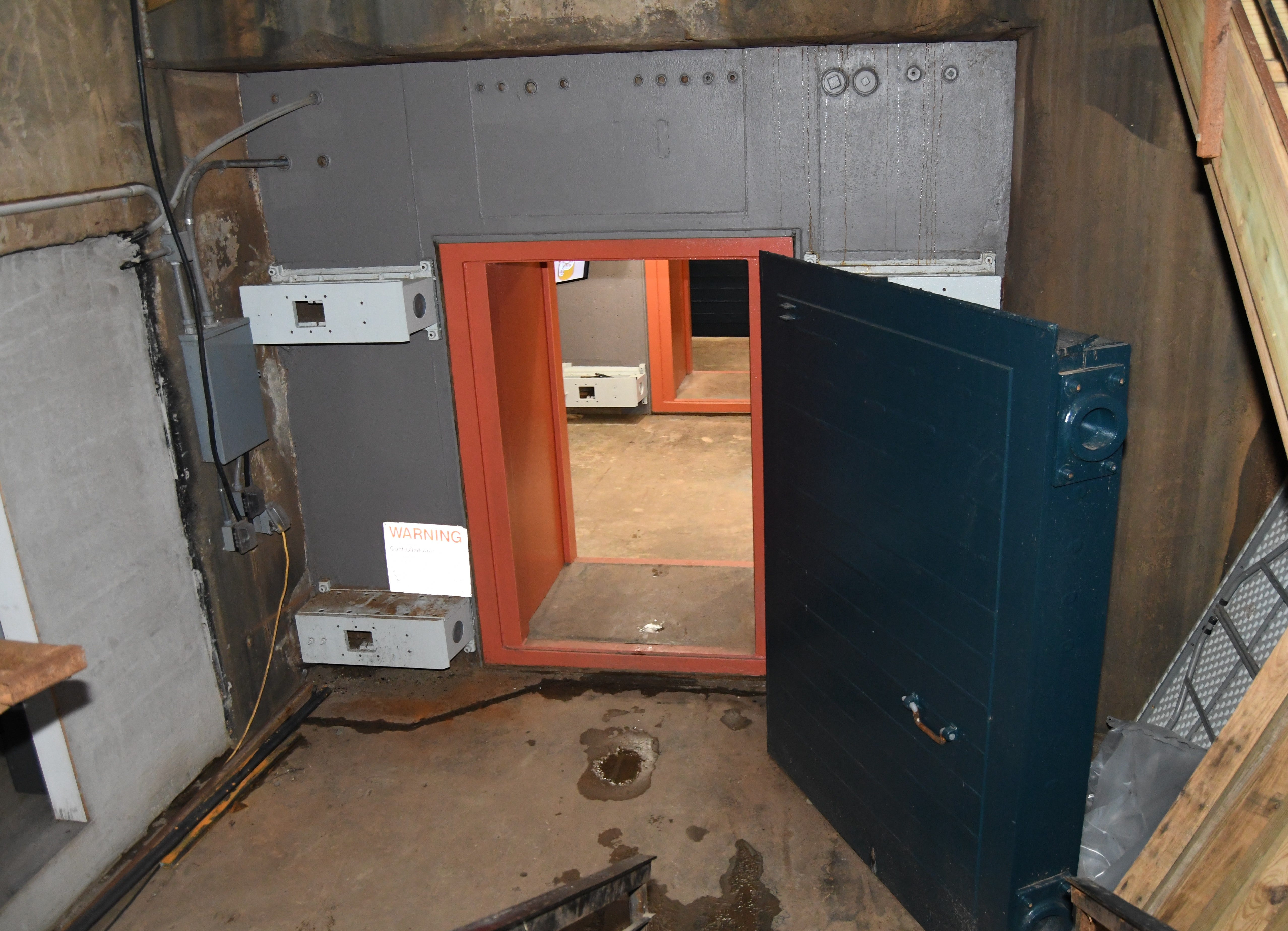 Upon descending down the stairs, visitors are greeted by two 6,000-pound doors, designed to withstand 1,000 psi of pressure.