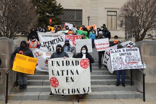 Protestors taking part in a license rally marched from the New Jersey Motor Vehicle Commission to the War Memorial in Trenton, New Jersey on January 13, 2021, where Governor Murphy conducts his daily press conference. The protestors were demanding access to drivers licenses for all.