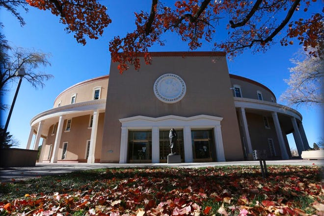 Leaves turn red outside the New Mexico State Capitol building, known as the Roundhouse, Tuesday, Nov. 17, 2020, in Santa Fe, N.M.
