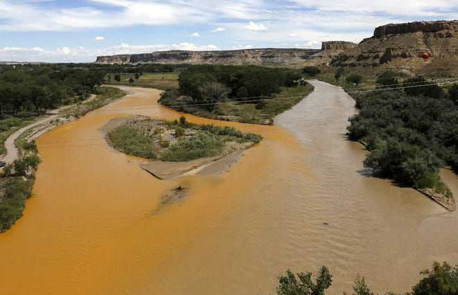 The confluence of the Animas and San Juan rivers is pictured Aug. 8, 2015, after the Gold King Mine spill.