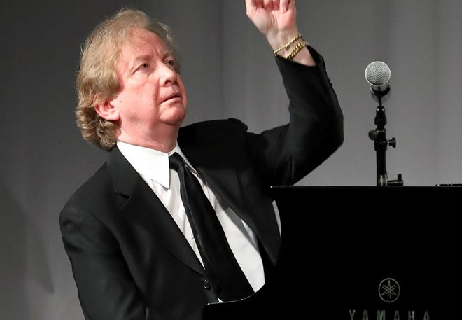 Pianist and composer John Bayless is the Waring's artistic director.
