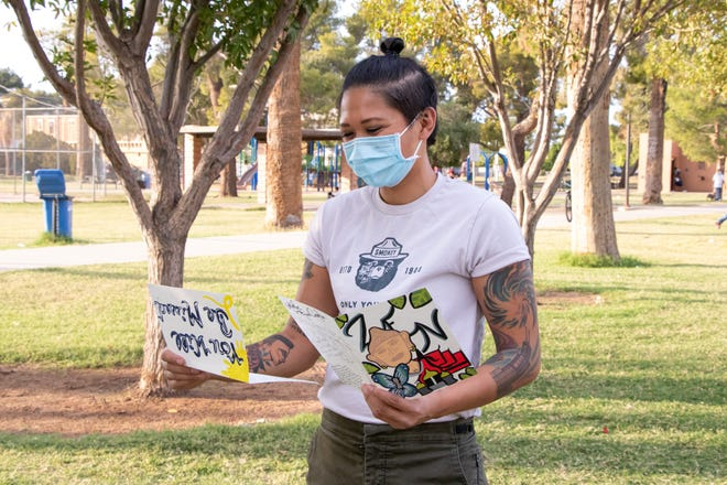 May Tiwamangkala looks back on the cards her fellow crew members wrote for her birthday and when she left the Perryville prison fire crew.