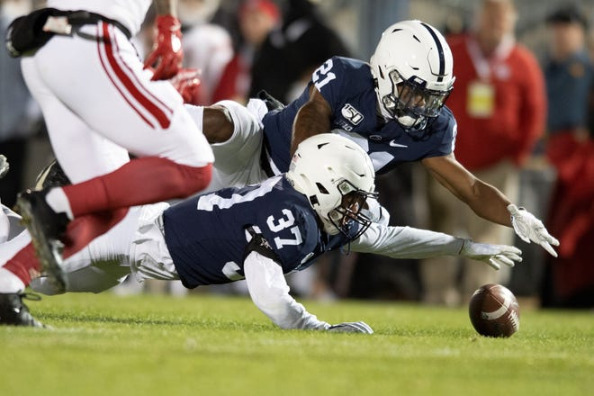 Penn State's Tyler Rudolph (21) and Drew Hartlaub (37) attempt to recover a kick by Rutgers in the fourth quarter of an NCAA college football game in State College, Pa., on Saturday, Nov. 30, 2019. Rudolph recovered the kick. Penn State defeated Rutgers 27-6. (AP Photo/Barry Reeger)