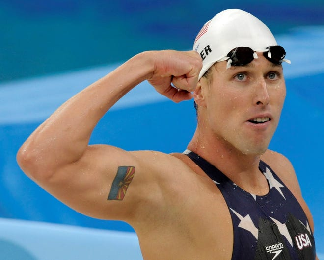 U.S. relay swimmer Klete Keller reacts after a men's 4x200-meter freestyle relay heat during the swimming competitions in the National Aquatics Center at the Beijing 2008 Olympics in Beijing, Tuesday, Aug. 12, 2008. (AP Photo/Thomas Kienzle)