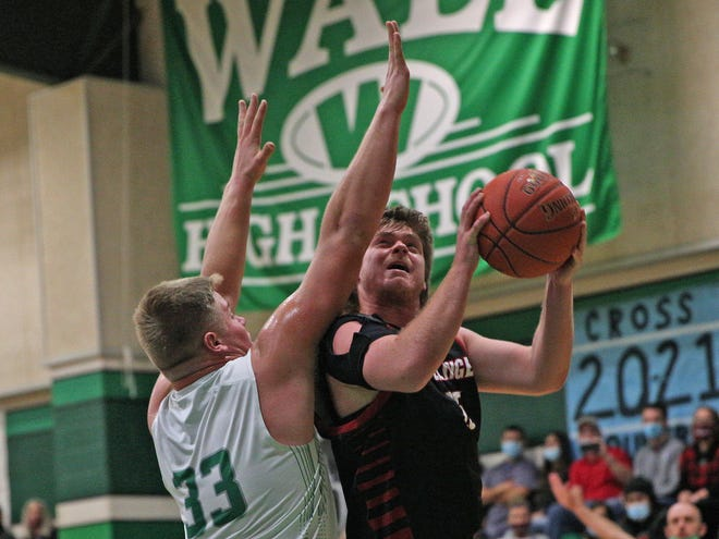 Tyler Vaughn, right, drives to the basket for Ballinger during a game against Wall on Tuesday, Jan. 12, 2021.