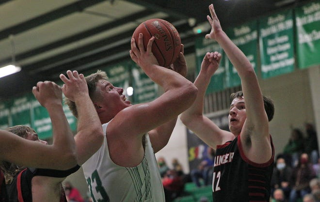 Tate Williams, center, drives to the basket for Wall during a game against Ballinger on Tuesday, Jan. 12, 2021.