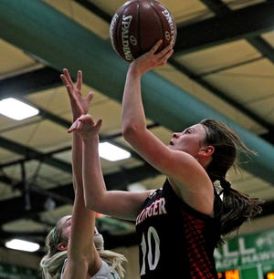 Jewel Klaras, right, lays the ball in for Ballinger during a game against Wall on Tuesday, Jan. 12, 2021.