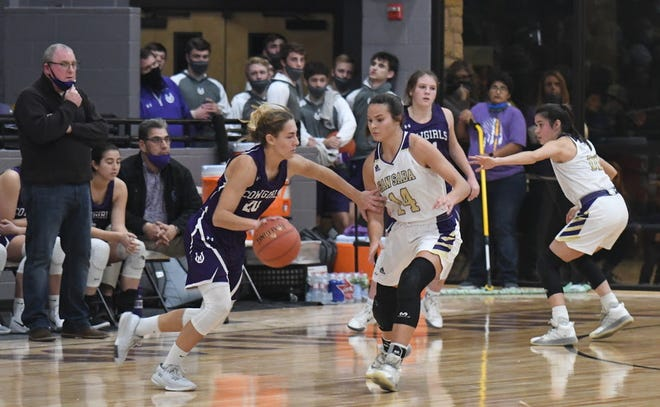 Mason's Tristin Keller looks to dribble past San Saba's Courtnee Cash during their basketball game Tuesday, Jan. 12, 2021, in San Saba.