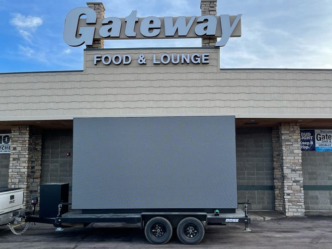 The Gateway Lounge will host an NFL Sunday playoff watch party using a big screen projector this weekend.