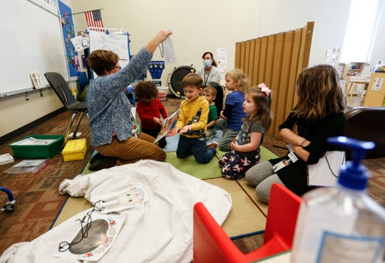 Preschool teacher Jody Matthews teachers her class in a group activity at the Republic School District Early Childhood Center on Wednesday, Jan. 13, 2021. The Republic school board will vote this month to seek a bond issue in April to build a new preschool.