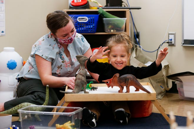 Republic voters agreed to expand preschool classroom space. In January, paraprofessional Jessica Stever plays with a student at the district's existing early childhood center.
