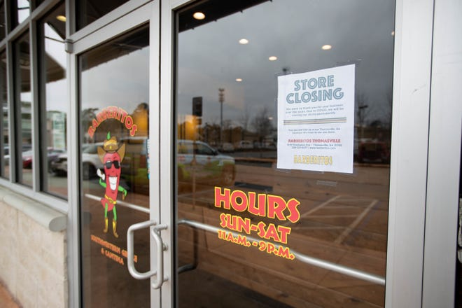 A closed sign is posted on the door of the Thomasville Road Barberitos location Wednesday, Jan. 13, 2021.