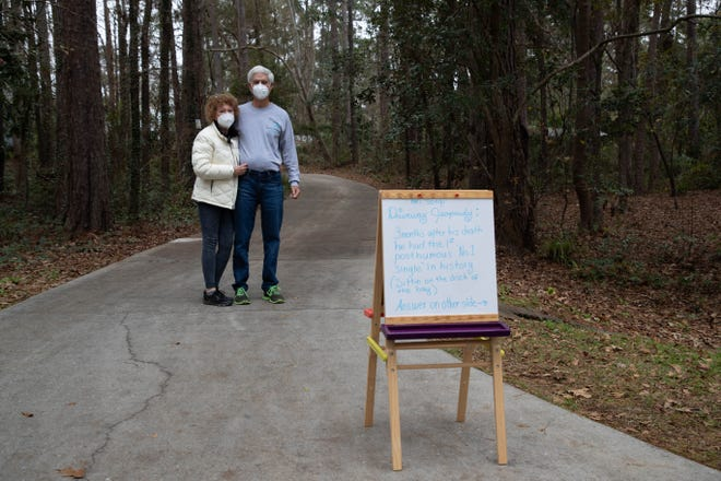 """Gene and Susan Walton stand in their driveway Wednesday, Jan. 13, 2021. The couple has created a game of """"driveway jeopardy"""" in their Brandon Woods at Lakeshore neighborhood."""