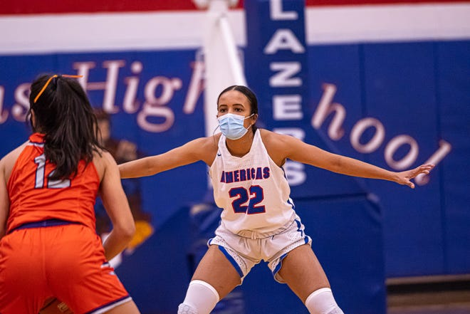 Americas player K. Collins watches for a pass by an Eastlake player. Americas High School defeated Eastlake High School 75-28 at Americas High School on Jan. 12, 2021.