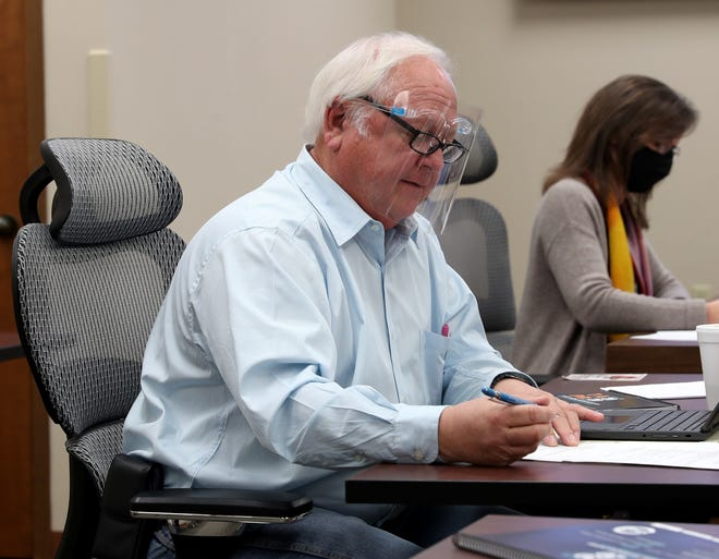 Mike Rucker, president of the WFISD Board of Trustees, takes notes during a special session Tuesday, Jan. 12, 2021, at the WFISD Education Center.
