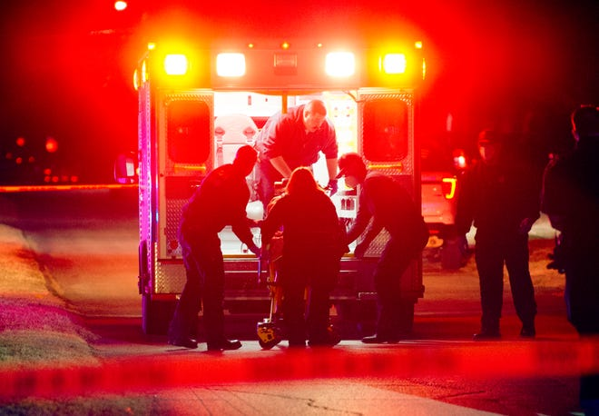 Wichita Falls emergency medics worked to transport a shooting victim to the hospital Sunday morning after responding to the scene on Pearl Avenue.