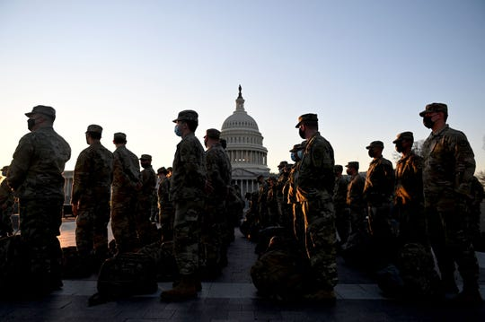 Members of the US National Guard arrive in the U.S. Capitol on Jan. 12, 2021 in Washington, D.C.