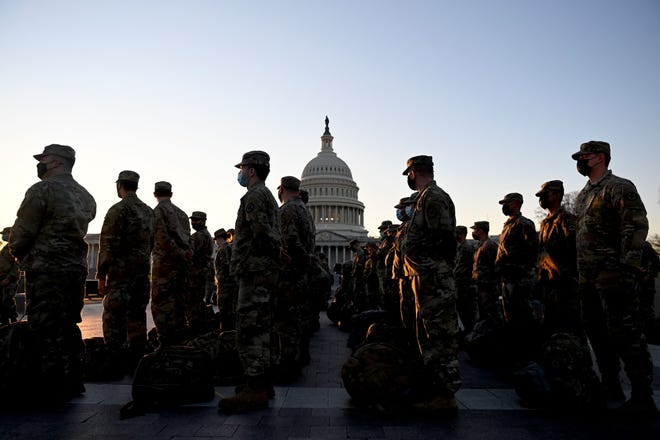 Members of the U.S. National Guard arrive at the  Capitol on Jan. 12 in Washington.