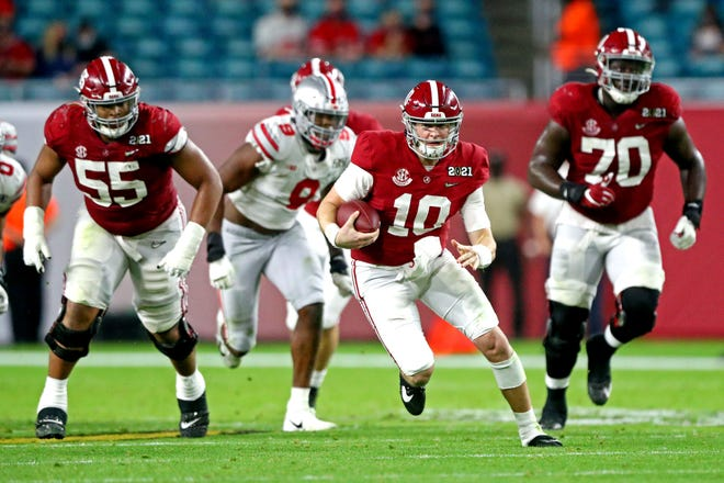 Alabama quarterback Mac Jones runs against Ohio State during the College Football Playoff national championship game at Hard Rock Stadium in Miami Garden, Fla.