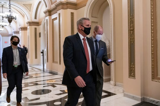 House Minority Leader Kevin McCarthy, R-Calif., walks to the chamber at the Capitol in Washington on Wednesday.