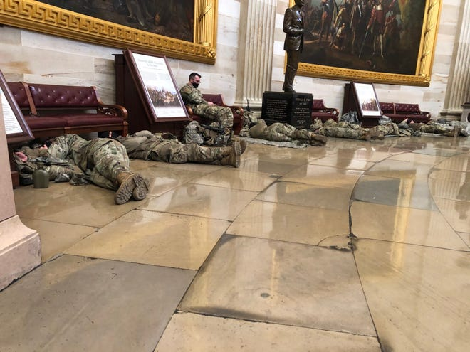 More Guard members sleep on the Capitol floor Wednesday before Congress proceeds with impeachment hearings.