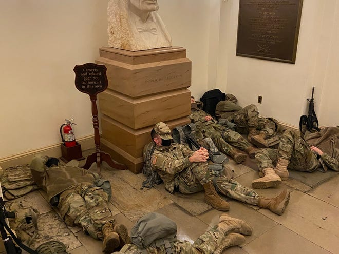 Inside, Guard members rest under a bust of Abraham Lincoln.