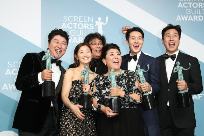 "Director Bong Joon-ho, center, and the cast of ""Parasite"" at last year's Screen Actors Guild Awards."