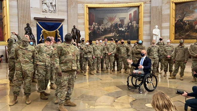 Rep. Brian Mast, R-Fla., speaks with National Guard members in the U.S. Capitol on Wednesday.