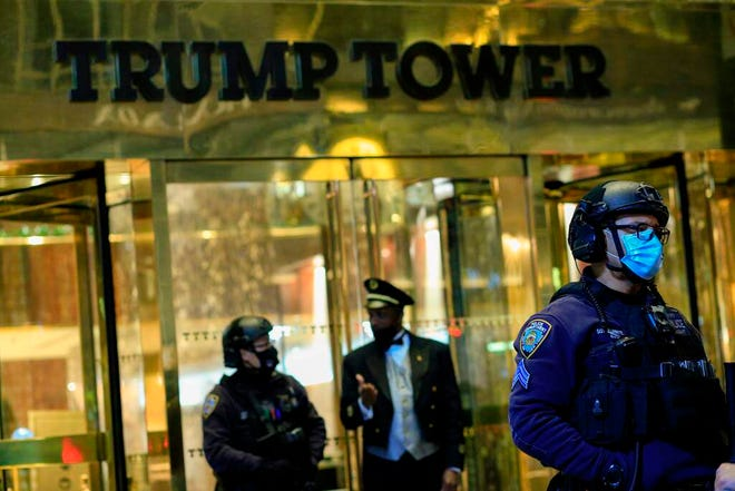 NYPD officers stand guard in front on Trump Tower on 5th Avenue the night before the Presidential Elections in New York, November 2, 2020.