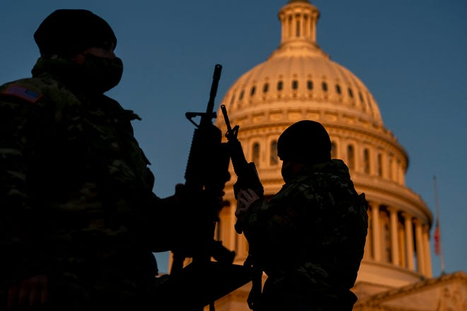 Weapons are distributed to members of the National Guard outside the U.S. Capitol on January 13, 2021. Security has been increased throughout Washington following the breach of the U.S. Capitol last Wednesday, and leading up to the Presidential inauguration.