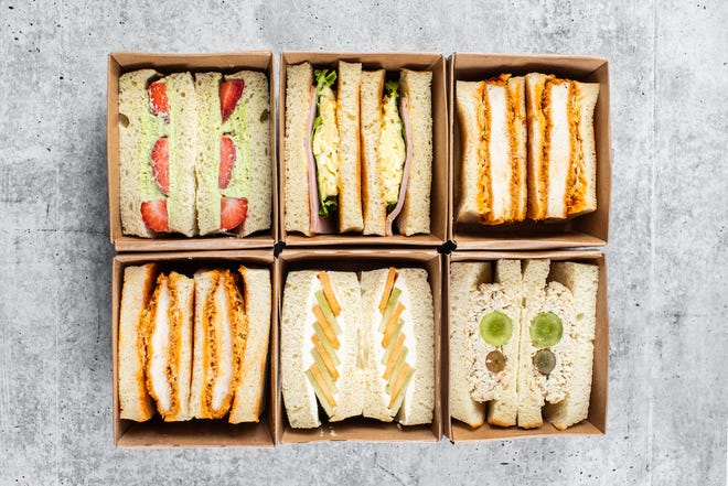 Sandoitchi makes gorgeous Japanese-style sandwiches like strawberry, clockwise from left, ham and eggs, hot truffle chicken, chicken salad, melon cream and pork katsu.