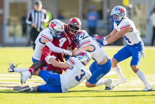 Westlake's secondary of Michael Taaffe, Carter Barksdale, Lucas Mireur and Chapel Stewart converge on Galena Park North Shore quarterback Dematrius Davis Jr. during the Chaps' 24-21 win in last week's Class 6A Division I state semifinal game. The Chaps' defense is on pace for the best statistical season in school history entering Saturday's championship game against Southlake Carroll.