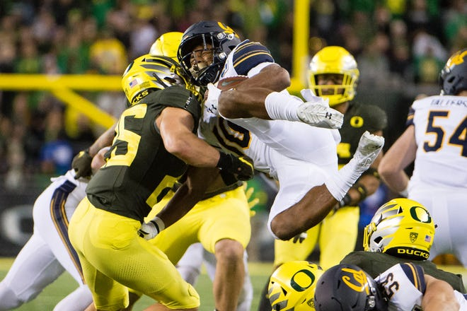 Cal wide receiver Jeremiah Hawkins is tackled by Oregon safety Brady Breeze during their 2019 game in Eugene, Ore. Hawkins has transferred to Texas State.