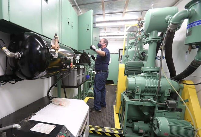 """David Hughes, a senior field service technician for SDMyers, is shown Thursday inside a transformer rig that is being prepped to travel from Tallmadge to a new """"center of excellence"""" that the company is opening in West Sacramento, California."""