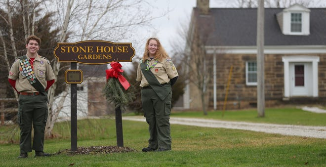 Alex and Kristen Blyler stand by the Stone House Gardens sign where, with the help of his sister, Alex put down a gravel pathway for his Eagle Scout award. Kristen also earned her Eagle award; her project was creating masks and bags out of old T-shirts, which were then donated to The Emergency Assistance Center.