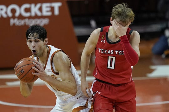 Texas Tech's Mac McClung (0) reacts after he was fouled while shooting by Texas' Brock Cunningham.