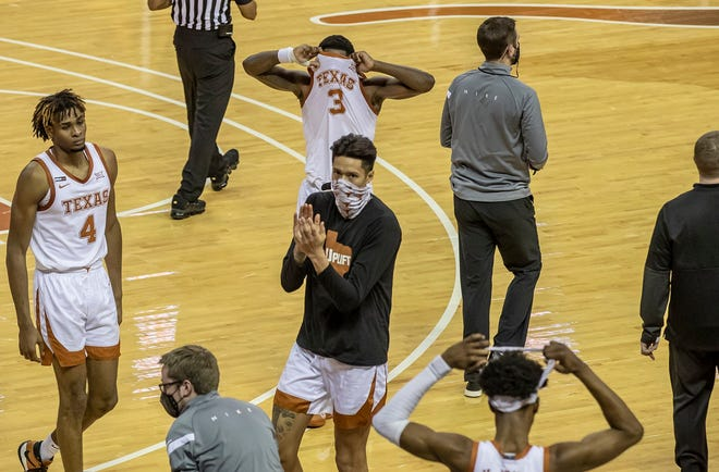 Texas guard Courtney Ramey (3) covers his face as he walks off the basketball court after losing 79-77 to Texas Tech on Wednesday night. Ramey, the team's leading scorer, made some uncharacteristic errors down the stretch as the Horns allowed a 10-point lead to slip away in the second half.