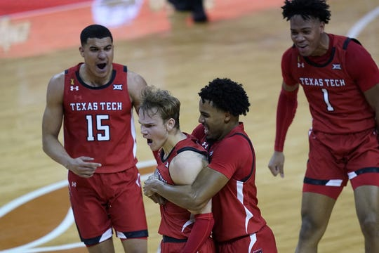 Texas Tech's Mac McClung is grabbed by teammate Kyler Edwards after hitting the winning basket against Texas.