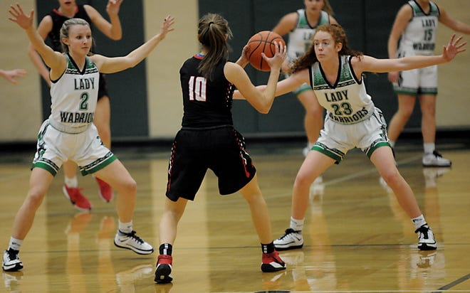 West Branch's Emma Egli (2) and Anna Lippiatt defend against New Philadelphia's Audrey Harr in a non-conference game at the West Branch Field House Wednesday, January 13, 2021.