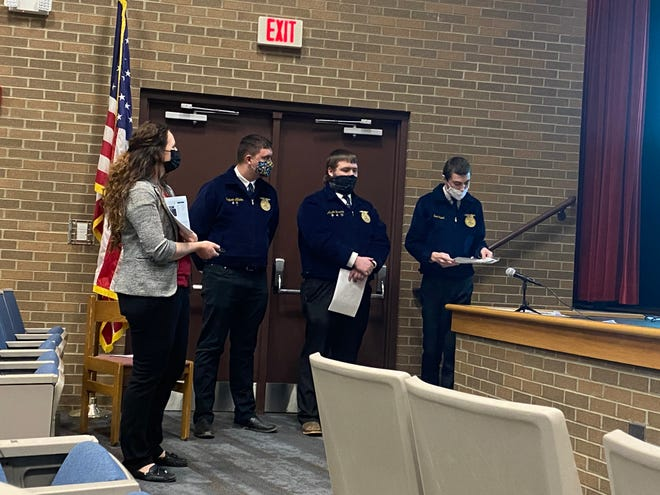 FFA adviser Danielle Haydocy and students present their request for funding for improvements. Left to right: Grayson Littleton (grade 12), Austin Barcroft (grade 12) and Evan Stuart (grade 10)